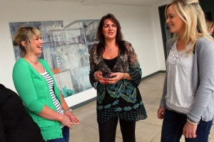 Eleanor McEvoy, who recently formed a new company called Budget Energy, talking with students Rachel Collins and Stephanie Morrison.