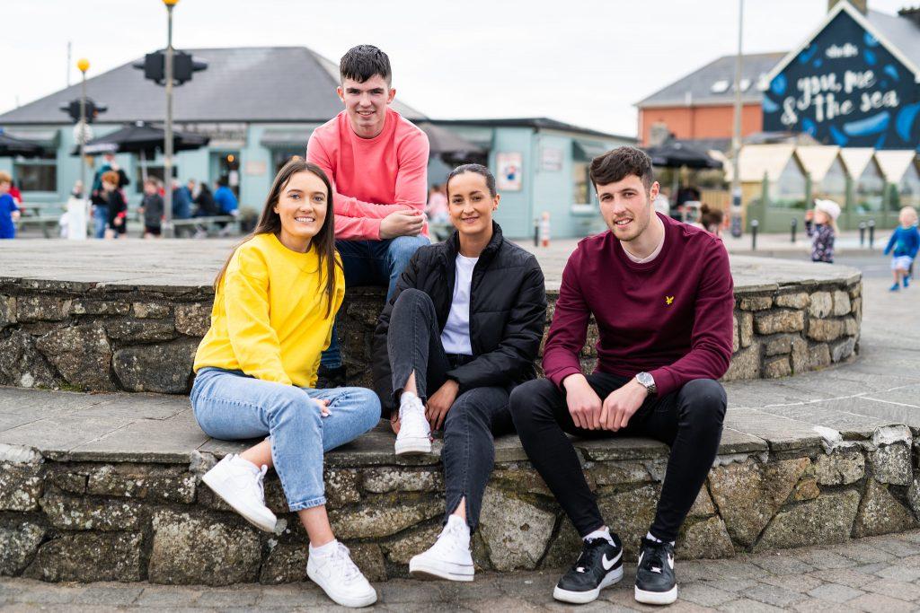 Students sitting by the sea, Strandhill, Sligo