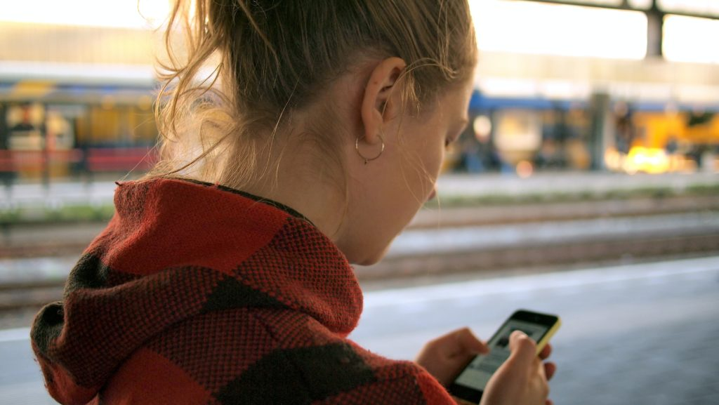 A woman texting on her phone